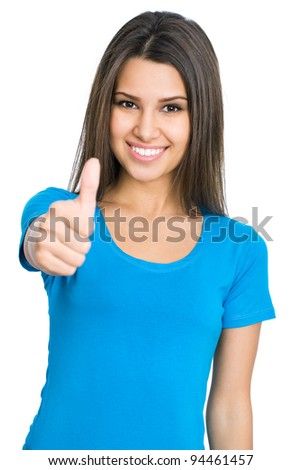 Happy female college student showing thumbs up - stock photo