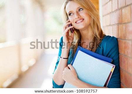happy female college student talking on mobile phone - stock photo