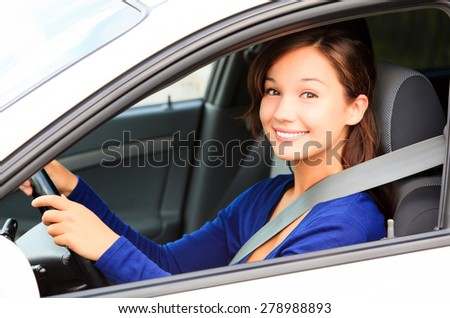 Happy female driver smiling to you - stock photo
