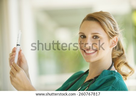 Happy female medical doctor - stock photo