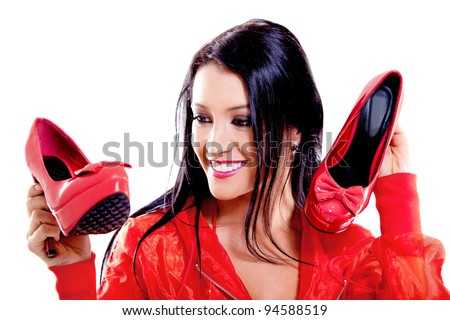 Happy female shoe lover - isolated over a white background - stock photo