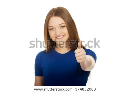 Happy female student showing thumbs up. - stock photo