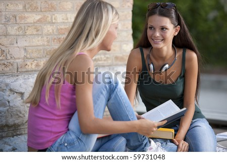 Happy female student students outdoors - stock photo
