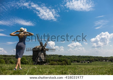 Happy female tourist traveling in Eastern Europe - stock photo