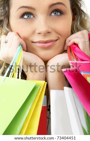 Happy female with bags looking aside - stock photo
