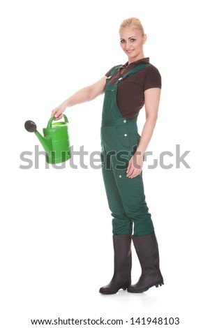 Happy Female Worker Holding Watering Cane Over White Background - stock photo