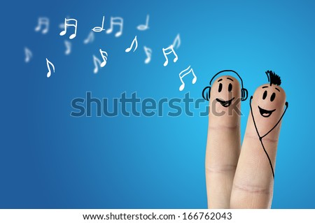happy finger couple listening to music - stock photo