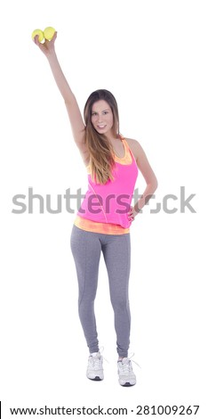 Happy fit woman holding tennis balls against a white background - stock photo