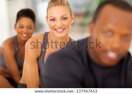 happy fitness people in aerobic class doing exercise - stock photo