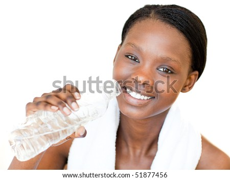 Happy fitness woman drinking water against a white background - stock photo