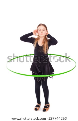 Happy five year old girl with hula hoop on white - stock photo