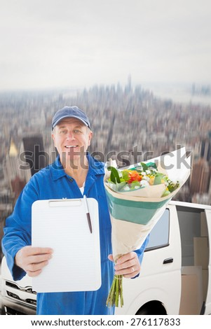 Happy flower delivery man showing clipboard against new york - stock photo