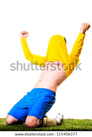 happy football or soccer player with jersey on his head isolated on white background - stock photo