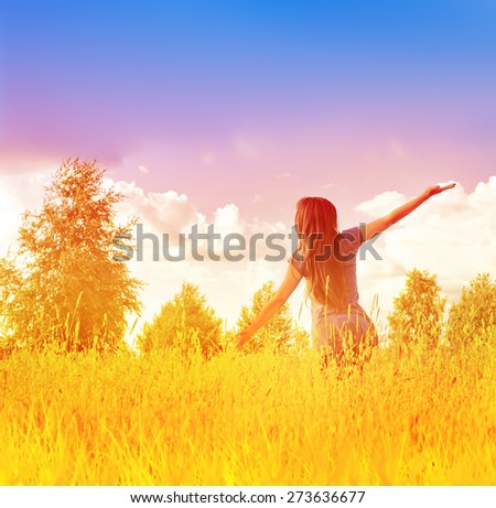 Happy free woman enjoying happiness, freedom and nature. - stock photo