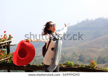 Happy  free woman enjoying nature. Freedom and serenity concept with female model in ecstatic enjoyment. Mixed race Asian Caucasian female model in 40 enjoying outdoor style, north in Thailand  - stock photo