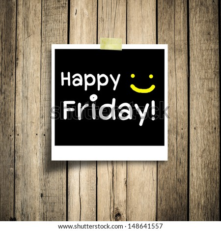 Happy Friday on grunge wooden background with copy space - stock photo