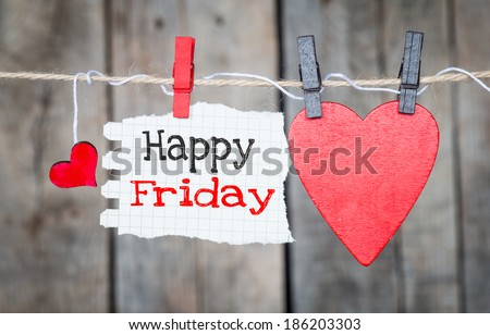 Happy Friday on instant paper and small red hearts hanging on the clothesline. On old wood background - stock photo