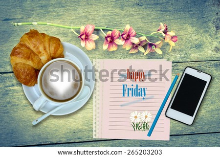 happy  Friday  words on notebook in wooden background. - stock photo