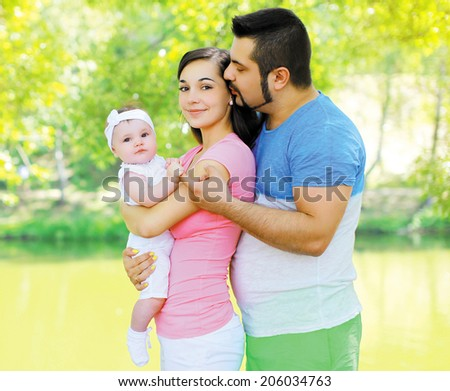 Happy friendly family in summer day - stock photo