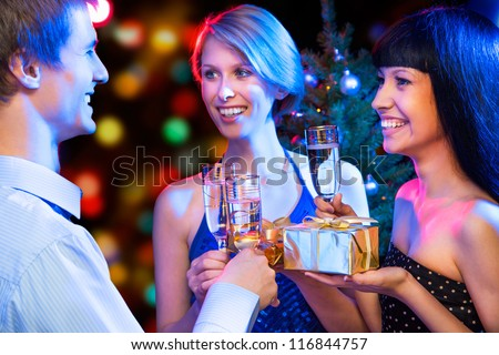 Happy friends congratulate each other on Christmas - stock photo