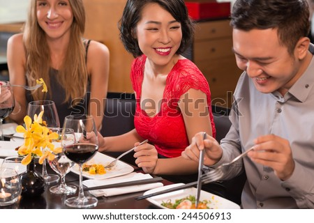 Happy friends eating a restaurant - stock photo