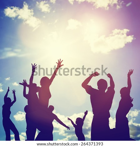 Happy friends, family jumping together in a circle having fun and expressing emotions of joy, freedom, success. Silhouettes on sunny sky - stock photo
