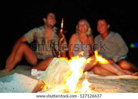 happy friends having fun around the bonfire - stock photo
