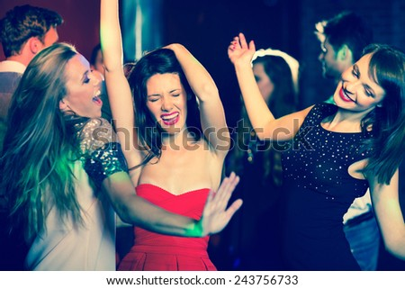 Happy friends having fun together at the nightclub - stock photo