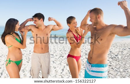 Happy friends having fun together on the beach - stock photo