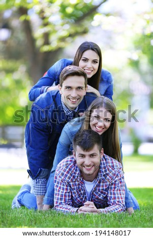 Happy friends in park - stock photo