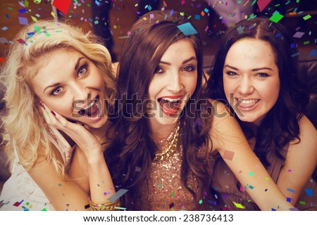 Happy friends making silly faces against flying colours - stock photo