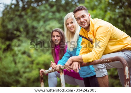 Happy friends on hike together in the countryside - stock photo