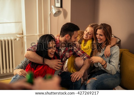 Happy friends spending time together at home. - stock photo