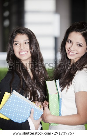 Happy friends with books, back to school - stock photo