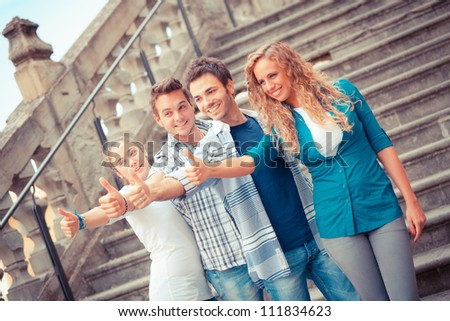 Happy Friends with Thumbs Up - stock photo