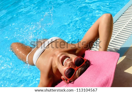 Happy fun woman face at pool on summer. Caucasian playful woman in white bikini on summer vacation - stock photo