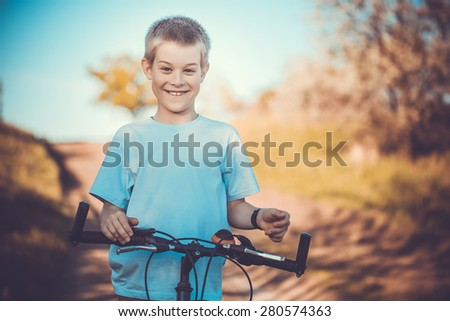 happy funny kid on bicycle. Active Leisure - stock photo