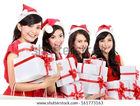 Happy funny people with christmas santa hat holding gift boxes on white background - stock photo