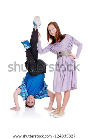 Happy funny  teenagers,  boy stands on her head. Isolated over white background - stock photo