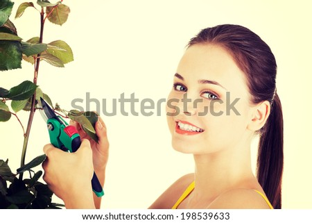 Happy gardener using pruning scissors - stock photo