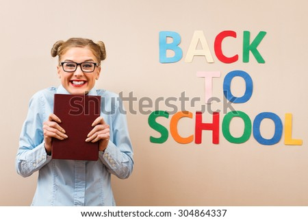 Happy geek girl  is excited because she is going back to school.Back to school! - stock photo