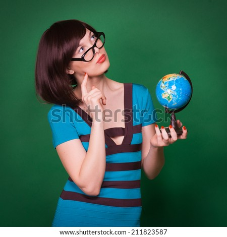 Happy geography teacher young woman hold globe and smlie - stock photo
