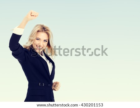 Happy gesturing young cheerful businesswoman, with blank copyspace area for text or slogan - stock photo