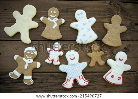 Happy Ginger Bread Cookies, with Decoration and without in brown and white colors, Man, Woman and Children - stock photo