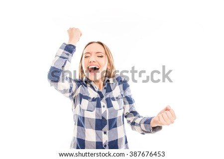Happy girl celebrating her victory with raised hands and screaming - stock photo