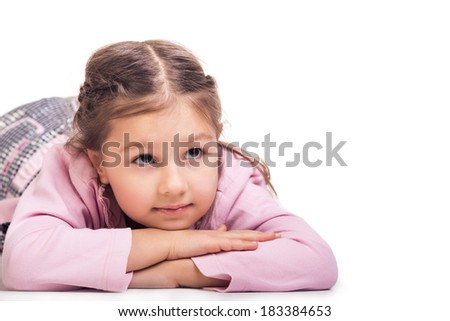 Happy girl daydreaming or fantasizing looking up - on white background - stock photo