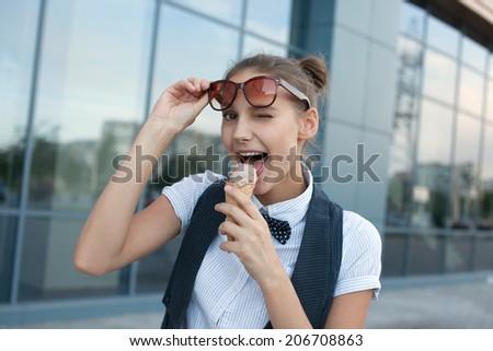 happy girl eating ice cream - stock photo