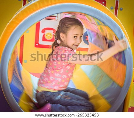 Happy girl enjoying in the Playground - stock photo