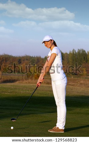 happy girl golf player ready for shot - stock photo
