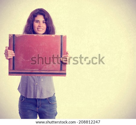 Happy girl holding a leather wallet - stock photo
